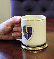 游客 to President Mauri Ditzler's office often see him holding a coffee mug.